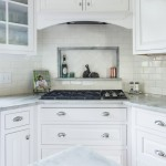 Custom tile backsplash niche with shelf for nicknacks in subway tile and marble