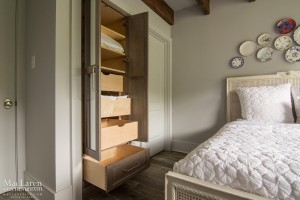 Linen closet with customized roll-out drawers